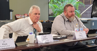 Two board memebers listening during a Board Meeting