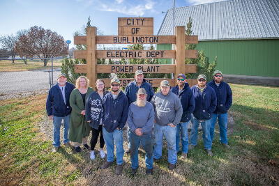 Burlington City Members Posing in Front of Burlington Electric Department