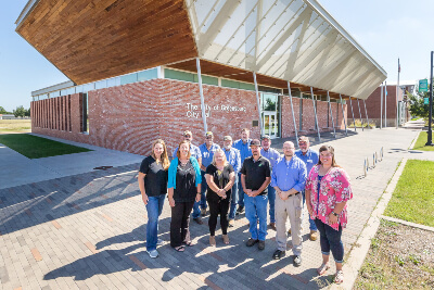 Greensburg City Members Standing In Front of Greensburg City Hall