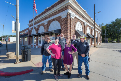 Haven City Members Standing In Front of Haven City Hall