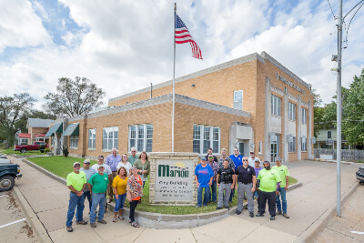 Marion City Members Standing In Front of Marion City Building & Community Center